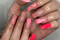 Quick Tip nail extensions with pink design.