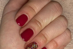 Nails painted in beautiful red polish