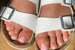 Pedicure with pastel French tips.